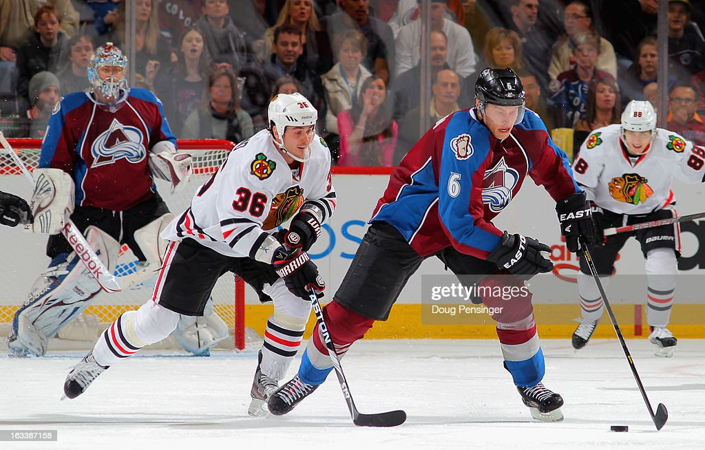 <a gi-track='captionPersonalityLinkClicked' href=/galleries/search?phrase=Erik+Johnson+-+Ice+Hockey+Player&family=editorial&specificpeople=457696 ng-click='$event.stopPropagation()'>Erik Johnson</a> #6 of the Colorado Avalanche controls the puck against Dave Bolland #36 of the Chicago Blackhawks at the Pepsi Center on March 8, 2013 in Denver, Colorado. The Avalanche defeated the Blackhawks 6-2 to end the Chicago's 30 game undefeated streak.