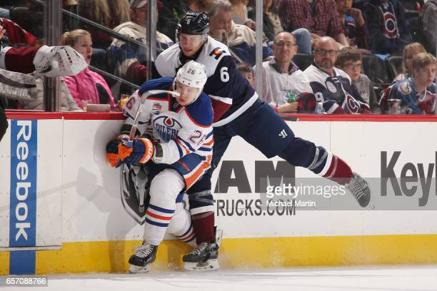 Erik Johnson of the Colorado Avalanche fights for position against Iiro Pakarinen of the Edmonton Oilers at the Pepsi Center on March 23 2017 in...