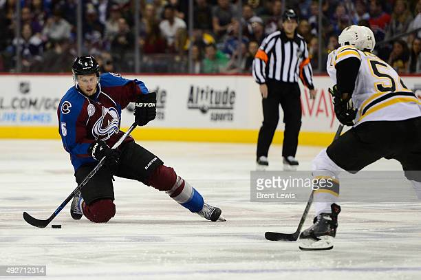 Erik Johnson of the Colorado Avalanche slides on his knee while trying to get around the defense Adam McQuaid of the Boston Bruins during the first...