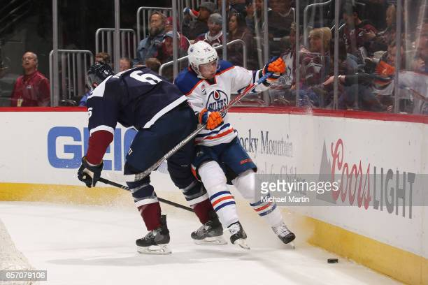 Erik Johnson of the Colorado Avalanche throws a hip into Iiro Pakarinen of the Edmonton Oilers at the Pepsi Center on March 23 2017 in Denver Colorado