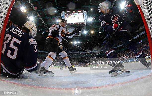 Erik Johnson of USA and Philip Gogulla of Germany battle for the puck in front of the net during the IIHF World Championship group H match between...