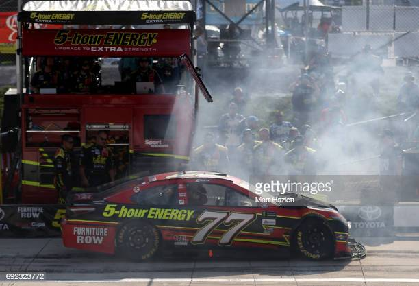 Erik Jones driver of the 5HOUR Energy Extra Strength Toyota has to come to pit road during the Monster Energy NASCAR Cup Series AAA 400 Drive for...