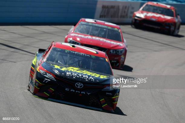 Erik Jones driver of the 5hour Energy Extra Strength Toyota leads a pack of cars during the Monster Energy NASCAR Cup Series Camping World 500 at...