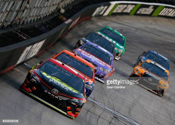 Erik Jones driver of the 5hour ENERGY Extra Strength Toyota leads a pack of cars during the Monster Energy NASCAR Cup Series Bass Pro Shops NRA Night...