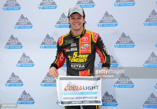 Erik Jones driver of the 5hour ENERGY Extra Strength Toyota poses with the Coors Light Pole Award after qualifying for the Monster Energy NASCAR Cup...