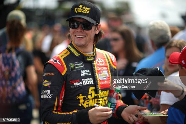 Erik Jones driver of the 5hour ENERGY Extra Strength Toyota signs autographs prior to the Monster Energy NASCAR Cup Series I Love NY 355 at The Glen...