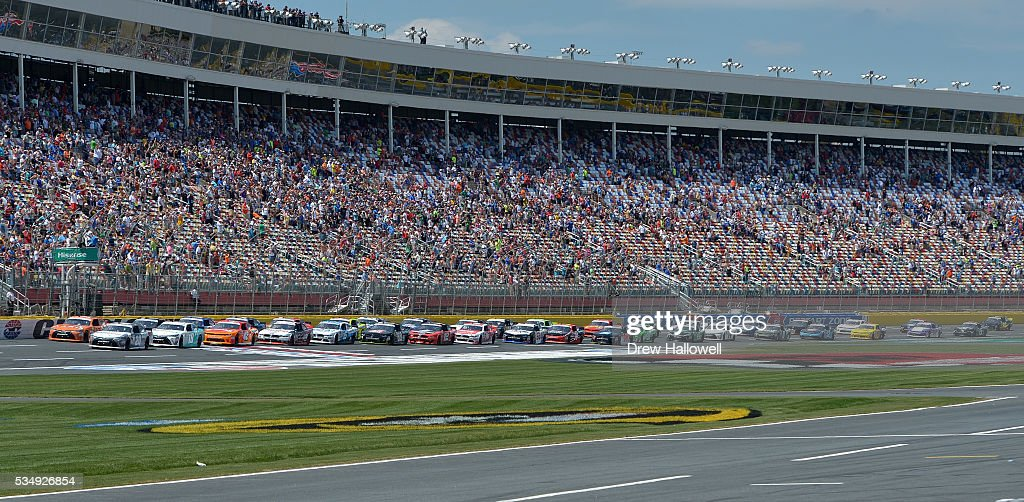 <a gi-track='captionPersonalityLinkClicked' href=/galleries/search?phrase=Erik+Jones+-+Race+Car+Driver&family=editorial&specificpeople=13494574 ng-click='$event.stopPropagation()'>Erik Jones</a>, driver of the #20 GameStop Toyota, and Daniel Suarez, driver of the #19 ARRIS Toyota, lead the field to the green flag to start the NASCAR XFINITY Series Hisense 300 at Charlotte Motor Speedway on May 28, 2016 in Charlotte, North Carolina.