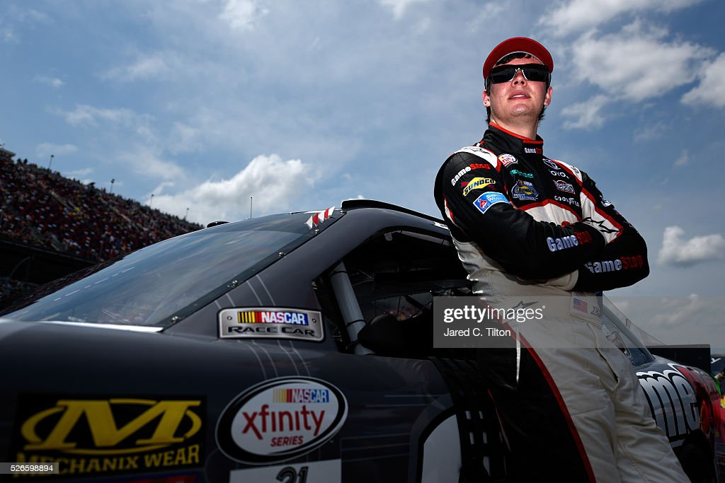 <a gi-track='captionPersonalityLinkClicked' href=/galleries/search?phrase=Erik+Jones+-+Racerf%C3%B6rare&family=editorial&specificpeople=13494574 ng-click='$event.stopPropagation()'>Erik Jones</a>, driver of the #20 GameStop Toyota, stands on the grid prior to during the NASCAR XFINITY Series Sparks Energy 300 at Talladega Superspeedway on April 30, 2016 in Talladega, Alabama.