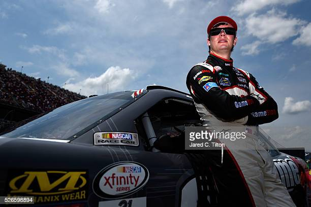 Erik Jones driver of the GameStop Toyota stands on the grid prior to during the NASCAR XFINITY Series Sparks Energy 300 at Talladega Superspeedway on...