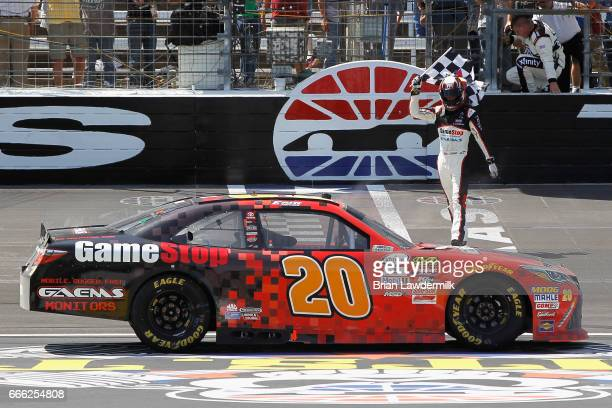 Erik Jones driver of the GameStop/GAEMS Toyota celebrates winning the NASCAR XFINITY Series My Bariatric Solutions 300 at Texas Motor Speedway on...