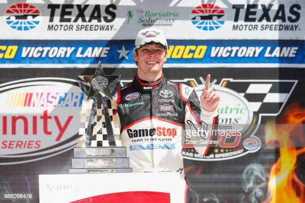 Erik Jones driver of the GameStop/GAEMS Toyota poses with the trophy in Victory Lane after winning the NASCAR XFINITY Series My Bariatric Solutions...