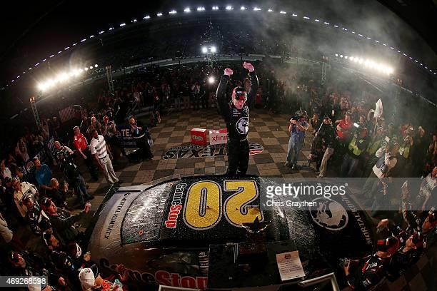 Erik Jones driver of the GameStop/Mortal Kombat X Toyota celebrates in victory lane after winning the NASCAR XFINITY Series O'Reilly Auto Parts 300...