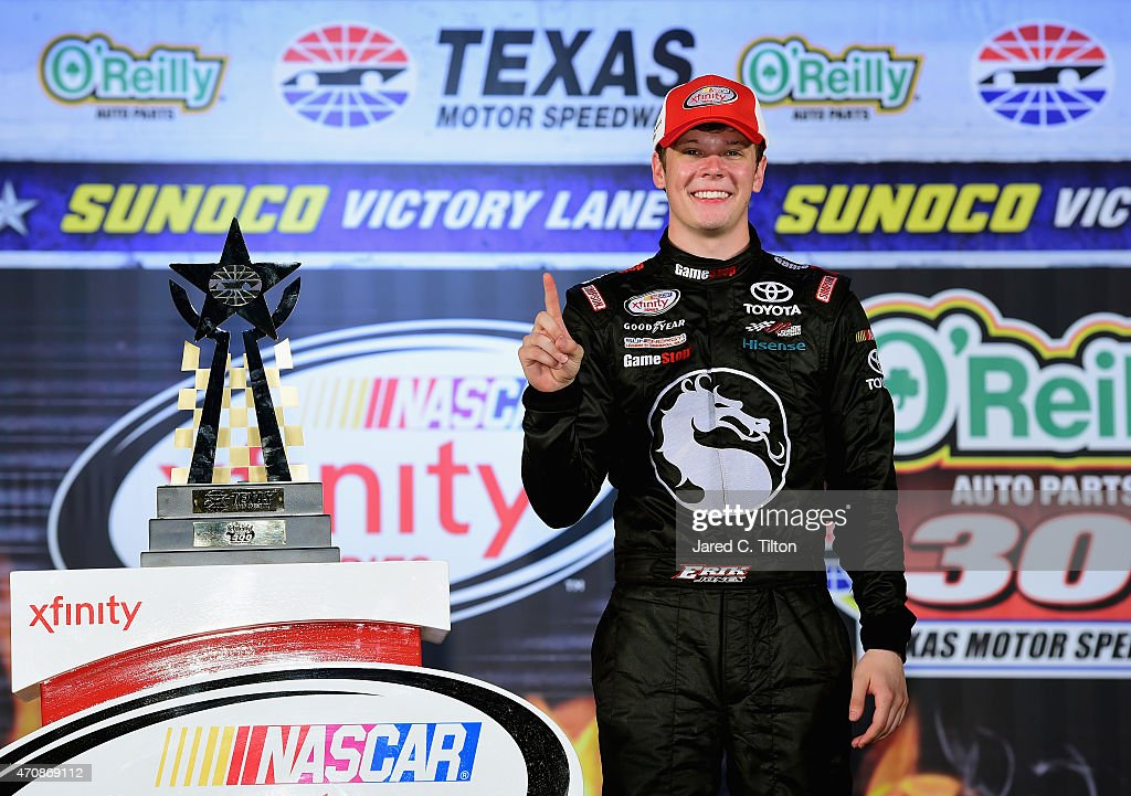Erik Jones driver of the GameStop/Mortal Kombat X Toyota celebrates in victory lane after winning the NASCAR XFINITY Series O'Reilly Auto Parts 300...
