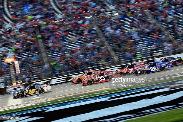 Erik Jones driver of the GameStop/Mortal Kombat X Toyota leads the field to the green flag for the running of the NASCAR XFINITY Series O'Reilly Auto...