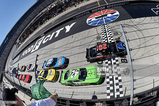 Erik Jones driver of the Gamestop/Performance Designed Products Toyota leads the field past the green flag to start the NASCAR XFINITY Series...
