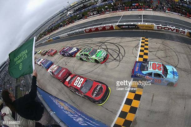 Erik Jones driver of the GameStop/Rise of the Tomb Raider 20 Year Celebration Toyota leads the field past the green flag to start the NASCAR XFINITY...