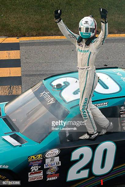 Erik Jones driver of the Hisense Toyota celebrates after winning the NASCAR XFINITY Series Drive for Safety 300 at Chicagoland Speedway on September...