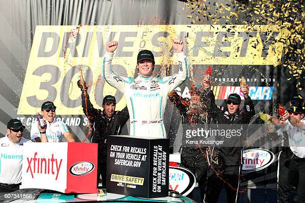 Erik Jones driver of the Hisense Toyota celebrates in Victory Lane after winning the NASCAR XFINITY Series Drive for Safety 300 at Chicagoland...