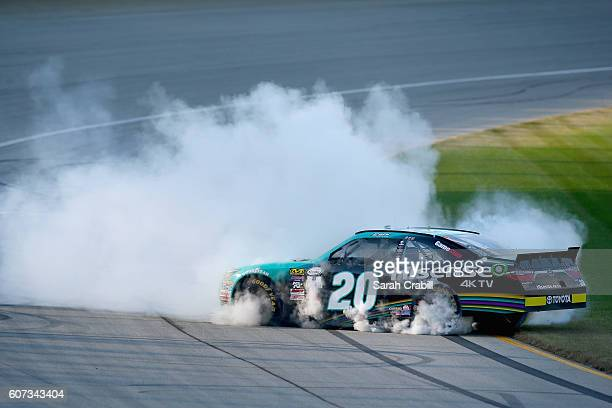 Erik Jones driver of the Hisense Toyota celebrates with a burnout after winning the NASCAR XFINITY Series Drive for Safety 300 at Chicagoland...