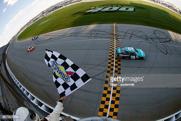 Erik Jones driver of the Hisense Toyota crosses the finish line to win the NASCAR XFINITY Series Drive for Safety 300 at Chicagoland Speedway on...
