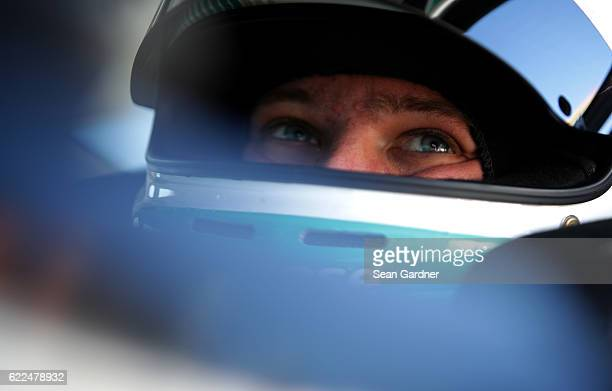 Erik Jones driver of the Hisense Toyota sits in his car during practice for the NASCAR XFINITY Series Ticket Galaxy 200 at Phoenix International...