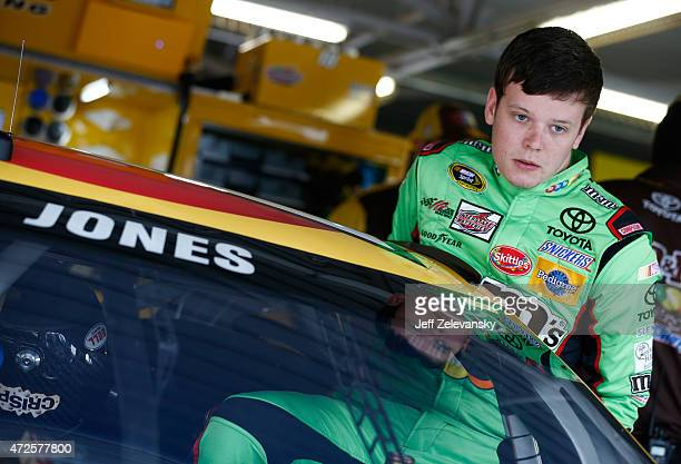 Erik Jones driver of the MM's Red Nose Day Toyota gets in his car during practice for the NASCAR Sprint Cup Series SpongeBob SquarePants 400 at...