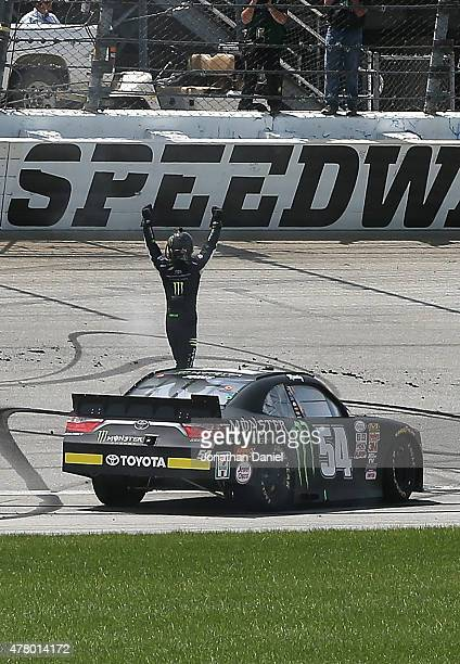 Erik Jones driver of the Monster Energy Toyota celebrates after winning the NASCAR XFINITY Owens Corning AttiCat 300 at Chicagoland Speedway on June...