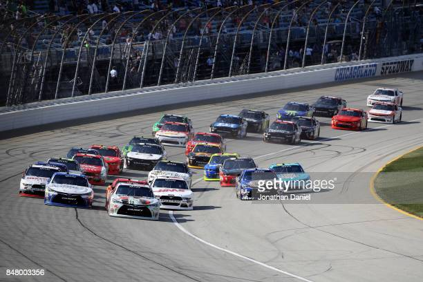 Erik Jones driver of the NBA 2K18/GameStop Toyota leads the field into turn one after taking the green flag to start the NASCAR XFINITY Series...