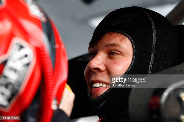 Erik Jones driver of the Reser's Fine Foods Toyota sits in his car during practice for the NASCAR XFINITY Series Axalta Faster Tougher Brighter 200...