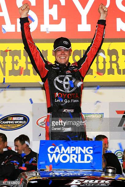 Erik Jones driver of the Special Olympics World Games Toyota celebrates in Victory Lane after winning the NASCAR Camping World Truck Series American...