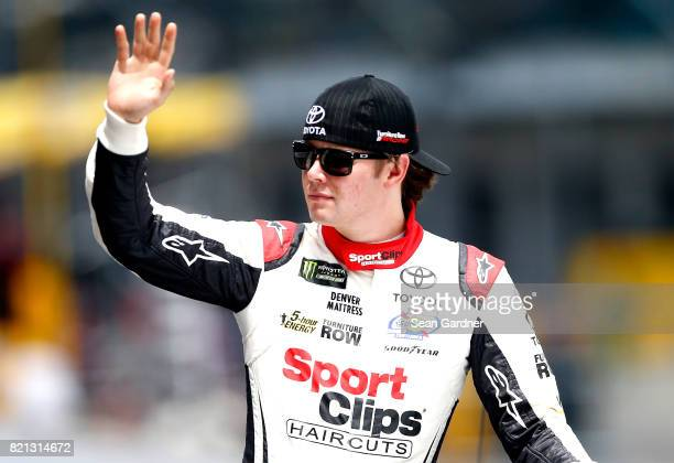 Erik Jones driver of the Sport Clips Toyota waves to the crowd prior to the start of the Monster Energy NASCAR Cup Series Brickyard 400 at...
