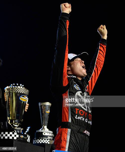 Erik Jones driver of the Toyota celebrates in victory lane after winning the series championship during the NASCAR Camping World Truck Series Ford...