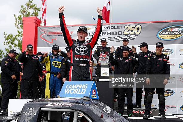 Erik Jones driver of the Toyota Toyota celebrates in victory lane after winning during the NASCAR Camping World Truck Series Chevrolet Silverado 250...