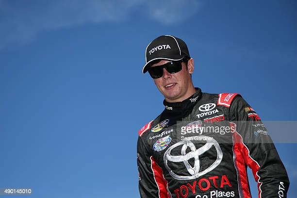 Erik Jones driver of the Toyota walks across the stage after being introduced prior to the NASCAR Camping World Truck Series UNOH 175 at New...