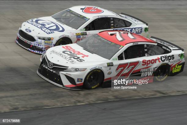 Erik Jones Furniture Row Racing Sport Clips Toyota Camry and Trevor Bayne Roush/Fenway Racing AdvoCare Ford Fusion race side by side during the...