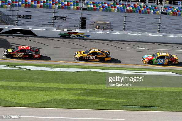 Erik Jones Matt Kenseth and Kyle Busch drive through the front stretch during practice for the NASCAR Monster Energy Cup Series Daytona 500 on...