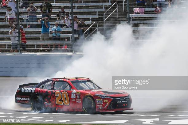 Erik Jones performs a burnout after winning the My Bariatric Solutions NASCAR Xfinity Series race on April 8 2017 at Texas Motor Speedway in Fort...