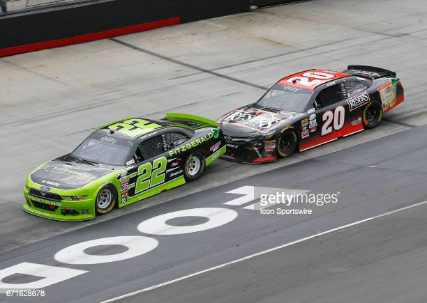 Erik Jones Reser's American Classic Toyota Camry bumps Ryan Blaney and then takes the lead during the Fitzgerald Glider Kits 300 NASCAR Xfinity...