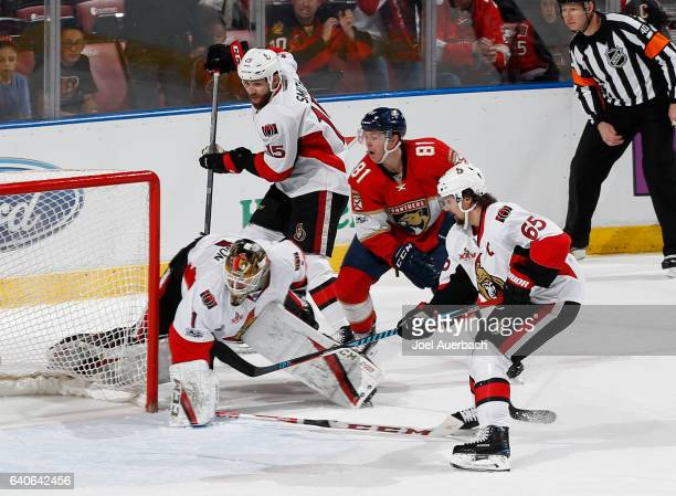 Erik Karlsson and Zack Smith of the Ottawa Senators look on as Jonathan Marchessault of the Florida Panthers slips the puck past Goaltender Mike...