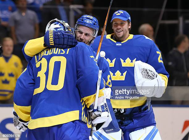 Erik Karlsson congratulates Henrik Lundqvist of Team Sweden after a 20 shutout win over Team Finland during the World Cup of Hockey 2016 at Air...