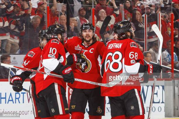 Erik Karlsson JeanGabriel Pageau Tom Pyatt and Chris Wideman of the Ottawa Senators celebrate a goal against the Pittsburgh Penguins in Game Four of...