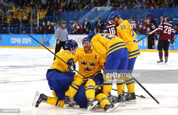 Erik Karlsson of Sweden celebrates with teammates after a goal in the second period against Latvia during the Men's Ice Hockey Preliminary Round...