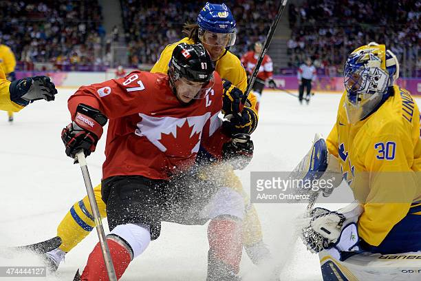 Erik Karlsson of Sweden gets physical with Sidney Crosby of the Canada as Henrik Lundqvist of Sweden defends the goal during the first period of the...