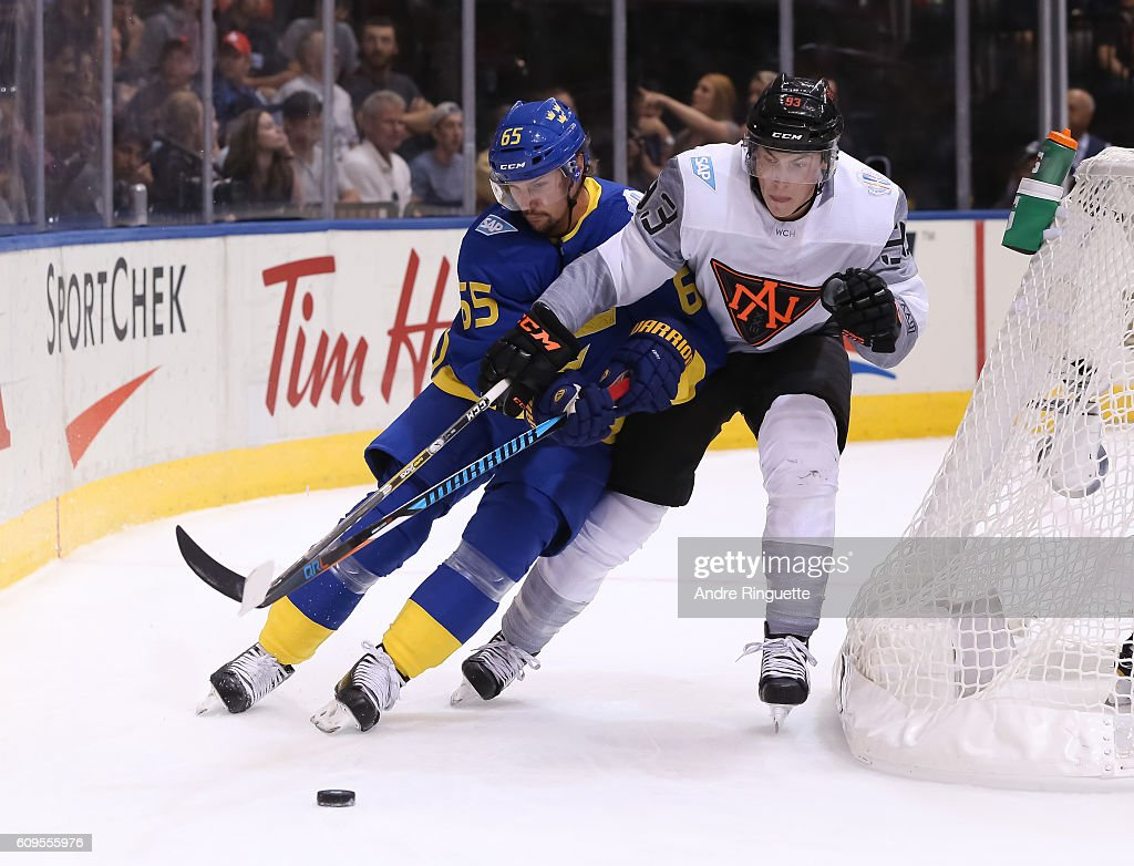 Erik Karlsson #65 of Team Sweden battles for the puck with Ryan Nugent-Hopkins #93 of Team North America during the World Cup of Hockey 2016 at Air Canada Centre on September 21, 2016 in Toronto, Ontario, Canada.