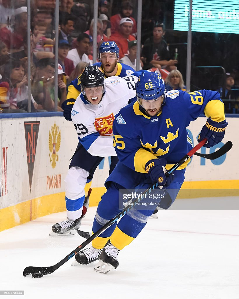 Erik Karlsson #65 of Team Sweden stickhandles the puck with Patrik Laine #29 of Team Finland chasing during the World Cup of Hockey 2016 at Air Canada Centre on September 20, 2016 in Toronto, Ontario, Canada.