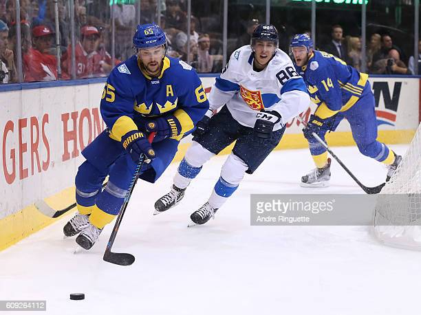 Erik Karlsson of Team Sweden stickhandles the puck with Teuvo Teravainen of Team Finland chasing during the World Cup of Hockey 2016 at Air Canada...