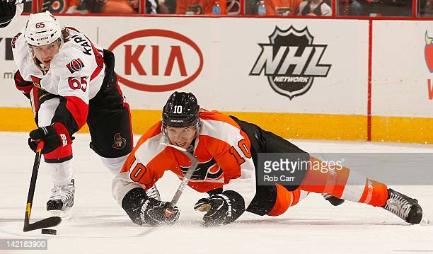 Erik Karlsson of the Ottawa Senators and Brayden Schenn of the Philadelphia Flyers fight for the puck during the second period at Wells Fargo Center...