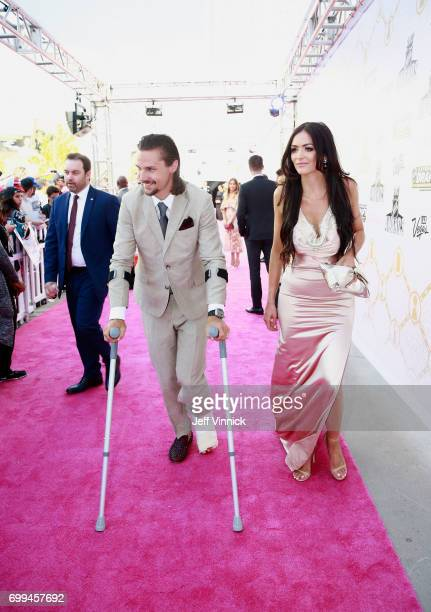 Erik Karlsson of the Ottawa Senators and guest arrive on the magenta carpet for the 2017 NHL Awards at TMobile Arena on June 21 2017 in Las Vegas...