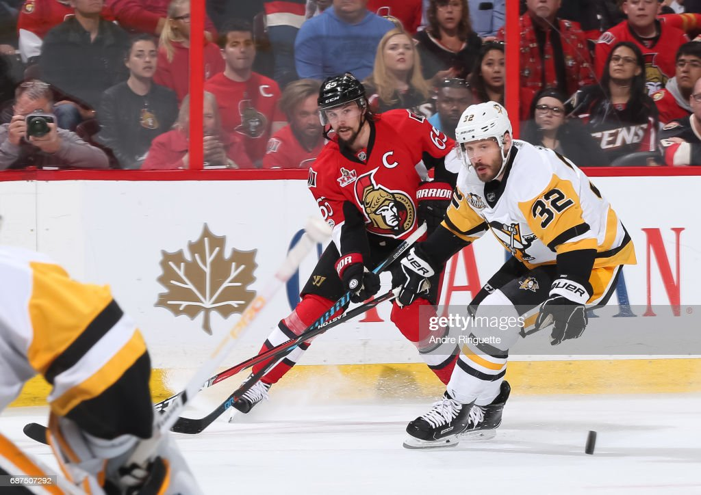 Erik Karlsson #65 of the Ottawa Senators battles for a loose puck with Mark Streit #32 of the Pittsburgh Penguins in Game Six of the Eastern Conference Final during the 2017 NHL Stanley Cup Playoffs at Canadian Tire Centre on May 23, 2017 in Ottawa, Ontario, Canada.