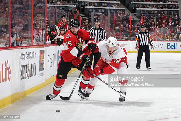 Erik Karlsson of the Ottawa Senators battles for position against Anthony Mantha of the Detroit Red Wings at Canadian Tire Centre on December 29 2016...